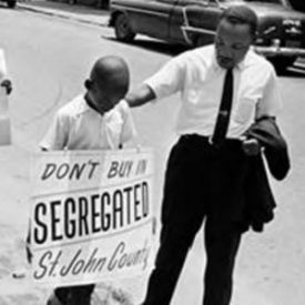 Image of Martin Luther King with young protester